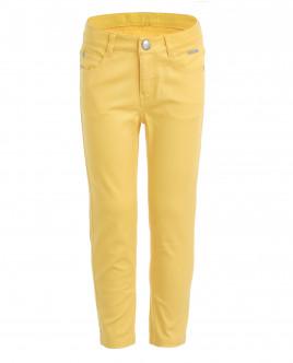 Желтые зауженные брюки OUTLET