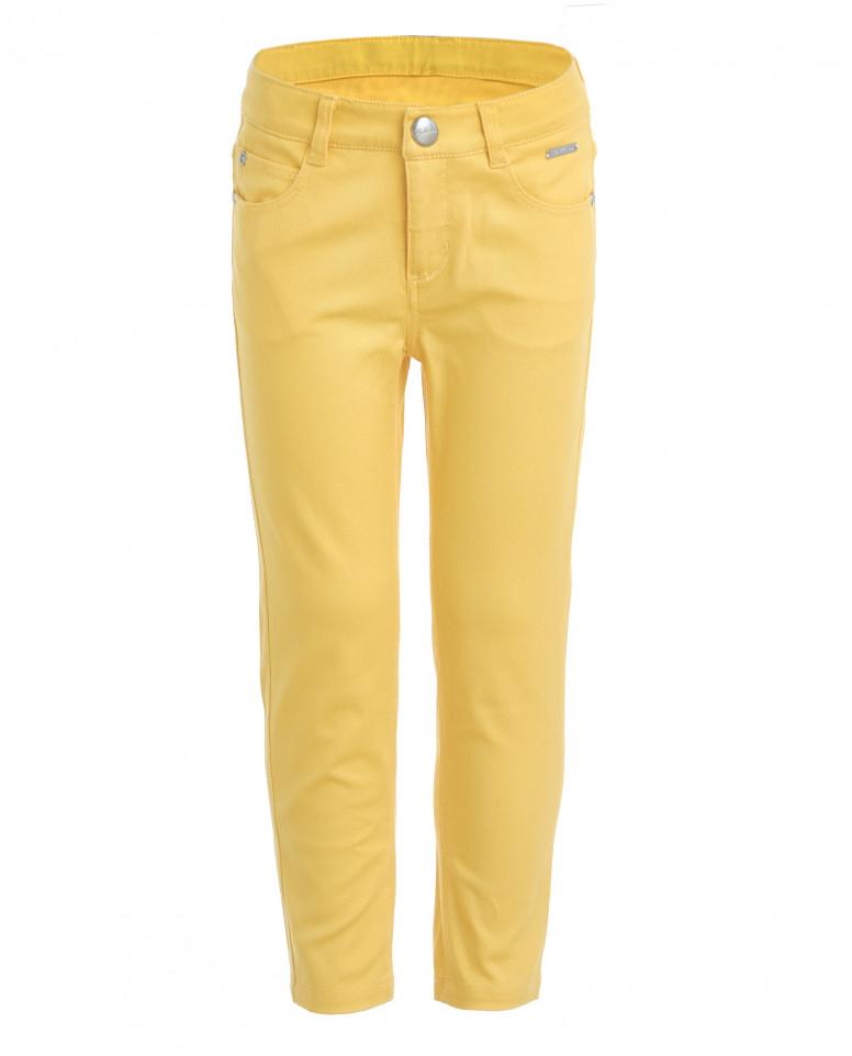 Желтые зауженные брюки