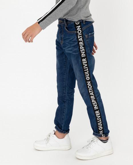 Синие джинсы с лампасами